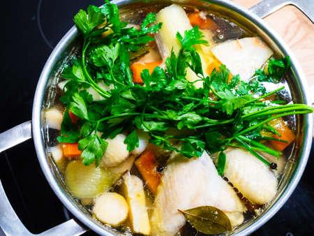 Photo pour Broth - boiling chicken soup in pot - image libre de droit