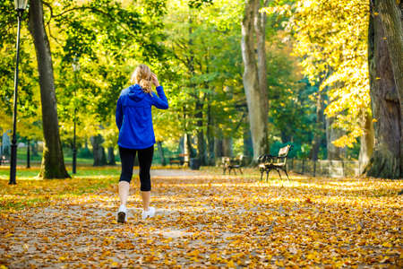 Photo for Middle-aged woman walking in city park - Royalty Free Image