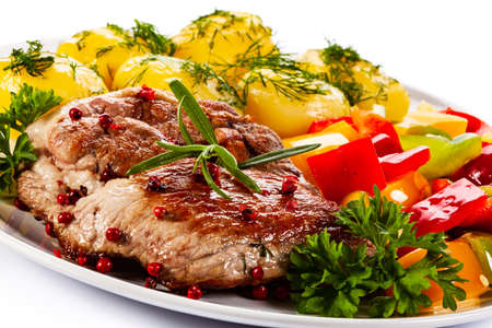 Photo pour Grilled steak with boiled potatoes and vegetables on white background - image libre de droit