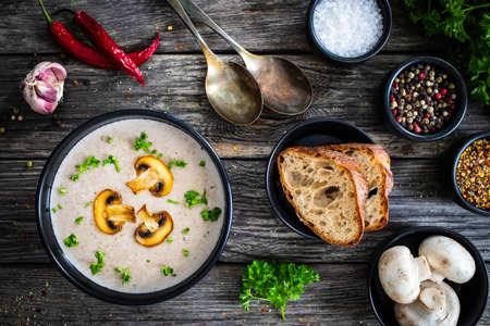 Foto für Cream of mushroom soup on wooden table - Lizenzfreies Bild