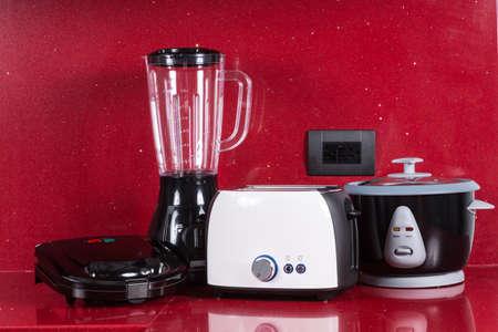Foto de Household appliances in modern kitchen red background. - Imagen libre de derechos