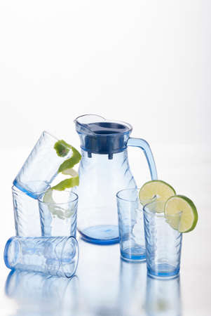 Foto de Set Of Glasses And Glass Jug; Photo On White Background. - Imagen libre de derechos