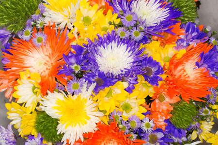 Foto de Arrangement of beautiful and colorful flowers; Bouquet made with different flowers. - Imagen libre de derechos
