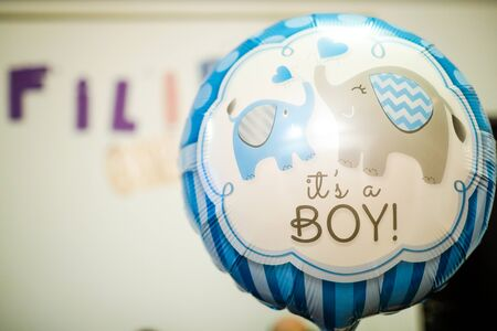 Photo pour Shallow depth of field (selective focus) image with a It's a boy message on a balloon during a baby shower - image libre de droit