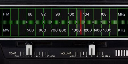 black vintage radio tuner closeup with tone and volume control