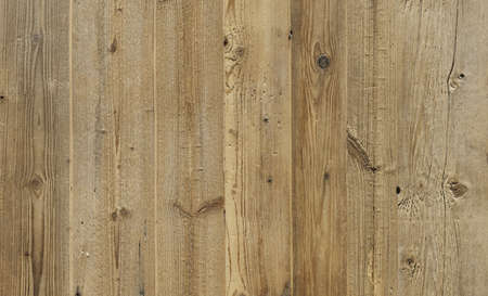 A brown, rustic wood texture with natural structure.