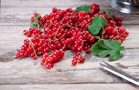 Fresh ripe red currants on a wooden table