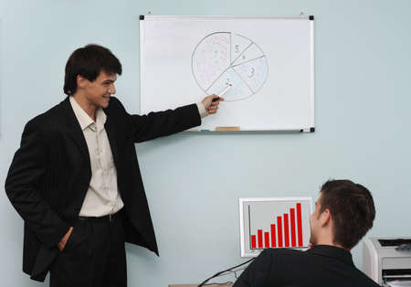 Two buisnessmen discussing the growth diagram on a meeting