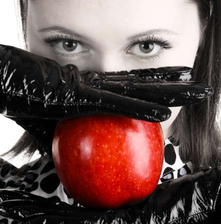Gorgeous woman holding a vibrant red apple