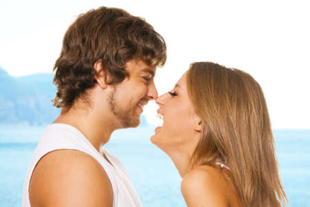 Young cheerful couple touching one another's nose
