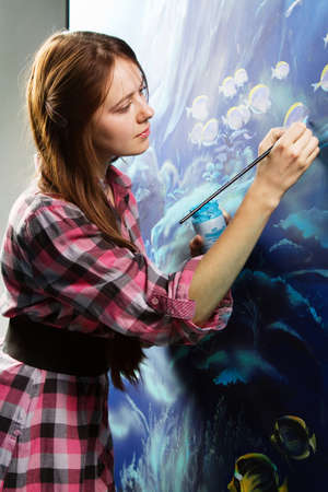 Photo for Professional painter at work, painting a home interior - Royalty Free Image