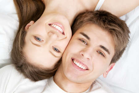 Beautiful young couple in bed, face portrait