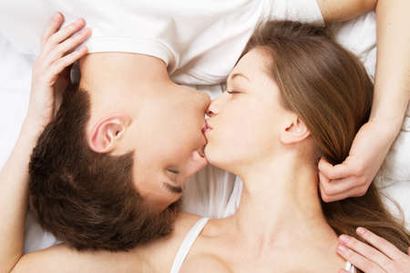 Photo for Beautiful young couple in bed, face portrait - Royalty Free Image