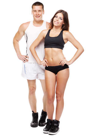Beautiful healthy-looking young couple in sports outfit