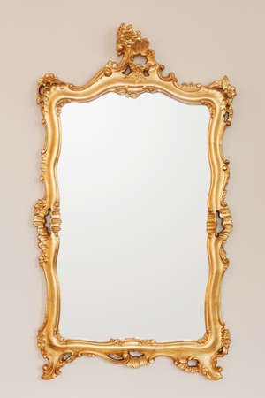Golden mirror frame on the wall