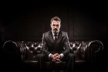 Photo pour Young confident businessman in a suit - image libre de droit