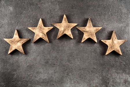 Photo for Five stars on dark background - Royalty Free Image