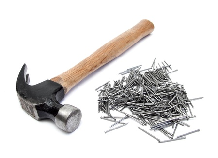 hand hammer with pile of nails over white
