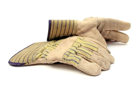 pair of working gloves over white