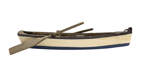 Isolated wooden boat with paddles