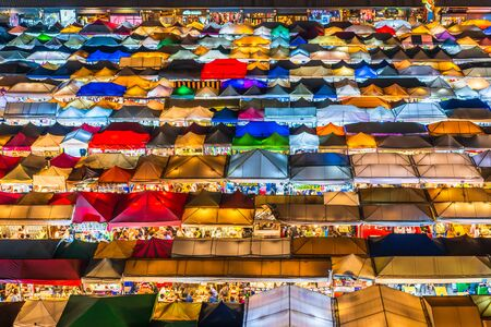 Bangkok, Thailand - Dec 6 ,2019 : Top view of Train Night Market Ratchada (Talad Rot Fai). market with plenty of shops with colorful canvas roofs at night in Bangkok, Thailand