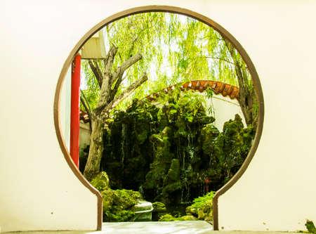 Chinese style round doorway to waterfall garden