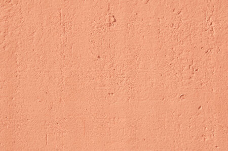 concrete wall painted in orange colour