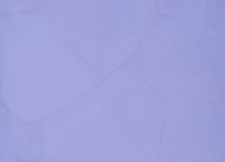 concrete wall painted in purple color