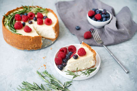 Photo for Homemade cheesecake new York decorated with  berries - Royalty Free Image