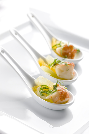 orange shrimp appetizer in decorative spoon