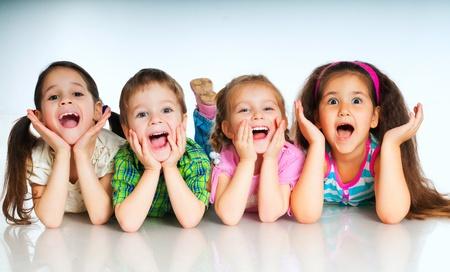 Photo pour laughing small kids on a white background - image libre de droit