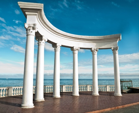 Ancient Greek columns against a blue sky and sea