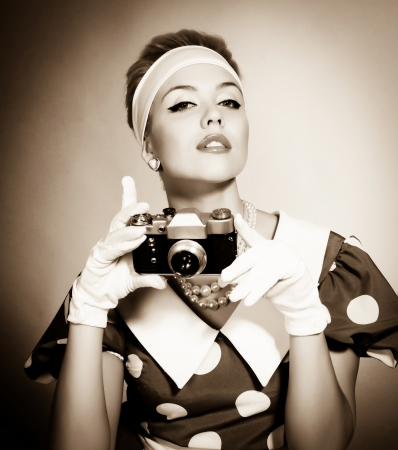 beautiful young lady with a camera in retro style