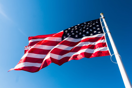 Photo for american flag waving in blue sky - Royalty Free Image