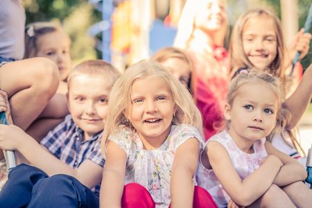 Photo pour Smiling Little Kids sitting together - image libre de droit
