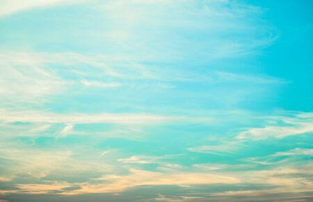 Foto de Light blue sky background with tiny fluffy clouds - Imagen libre de derechos
