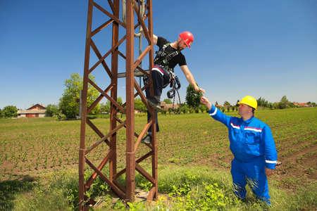 Photo pour Two tehnicians are working on power transmission line - image libre de droit