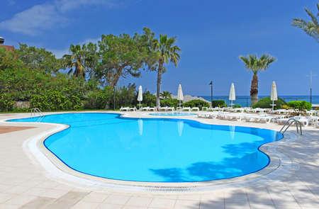 Swimming pool area near Mediterranean Sea in Antalya Turkey