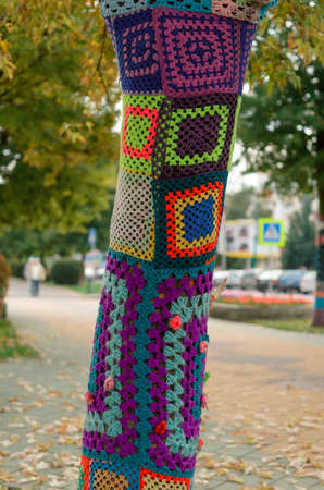 Brest, Belarus - September 19, 2015: Decorated tree trunks colorful designs and symbols texture of the material.