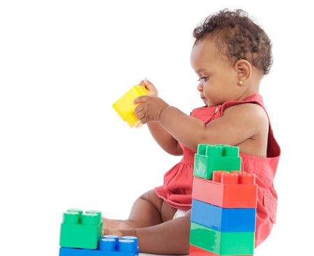 Adorable  girl playing with building blocks