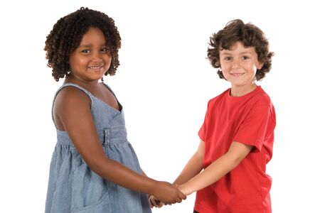 two handsome children of different races with their hands together