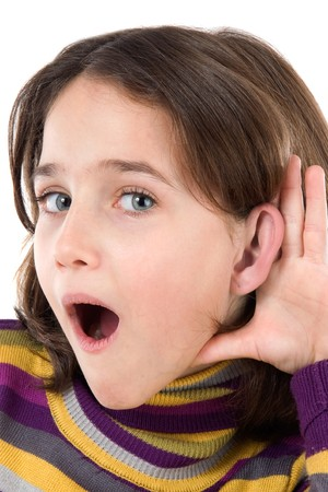 Adorable girl hearing on a over white background