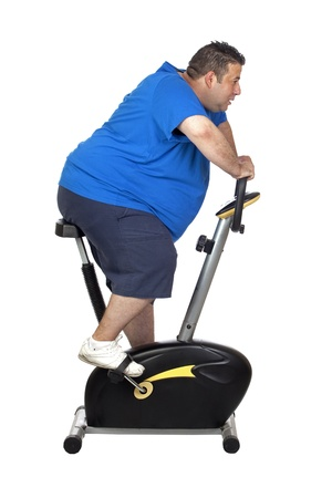 Fat man playing sport isolated on a white background