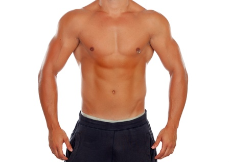 Handsome shirtless young man with defined muscles and a piercing isolated on a white background