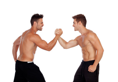Photo pour Couple of handsome muscled men competing isolated on a white background - image libre de droit