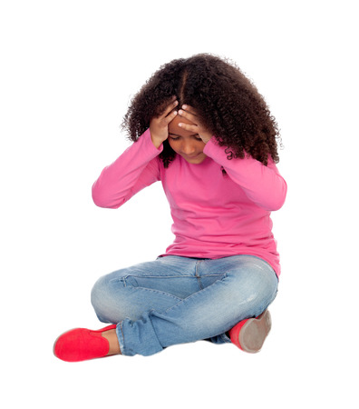 Adorable little african girl with headache isolated on a white background