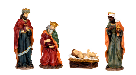 Foto per The three wise men and baby Jesus. Ceramic figures isolated on white background - Immagine Royalty Free