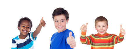 Photo pour Happy classmates saying Ok with their thumbs up isolated on a white background - image libre de droit