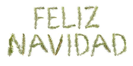 Spruce twigs forming the phrase 'Feliz Navidad' isolated on white
