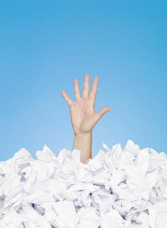 Photo pour Human hand buried in white paper - image libre de droit